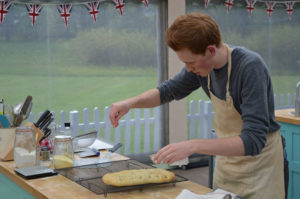 WARNING: Embargoed for publication until 21:00:01 on 28/09/2016 - Programme Name: The Great British Bake Off 2016 - TX: n/a - Episode: The Great British Bake Off 2016 - episode 6 (No. 6) - Picture Shows: Technical. Tom finishing his bread with salt. **NOT FOR PUBLICATION BEFORE 2100 HOURS WEDNESDAY 28th SEPT 2016** - (C) Love Productions - Photographer: Tom Graham